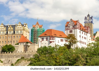 The Bernburg castle with blue sky and clouds on the river Saale