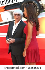 """Bernie Ecclestone and Fabiana Flosi arriving for the """"Rush"""" World premiere at the Odeon Leicester Square, London. 02/09/2013"""