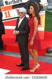 """Bernie Ecclestone, Fabiana Flosi arriving for the """"Rush"""" World premiere at the Odeon Leicester Square, London. 02/09/2013"""