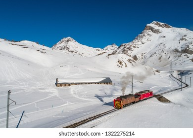 Bernina Express, steam train with snowplow turbine