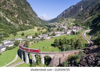 Bernina Express, viaduct of Brusio in Valposchiavo. Red train of Bernina, Unesco World Heritage. 01.07.2018