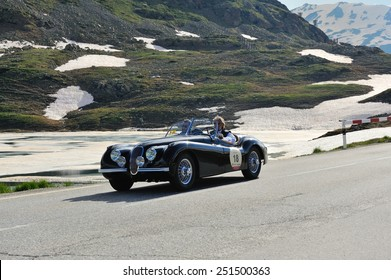 BERNINA PASS, SWITZERLAND - JUNE 14: A black Jaguar XK 120 OTS takes part to the Summer Marathon classic car race on June 14, 2014 at Bernina Pass. This car was built in 1950
