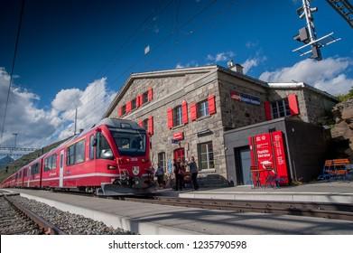 Bernina Switzerland 27July 2015: hospice railway station red train bernina
