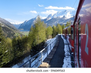 Bernina, Switzerland: trains of the Rhaetian Railway in transit along the line Tirano - St.Moritz during a beautifun sunny day.