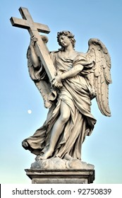 Bernini's marble statue of angel with cross, Saint Angelo Bridge in Rome, Italy (evening time)
