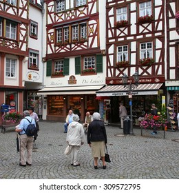 BERNKASTEL, GERMANY - JULY 19, 2011: Tourists stroll in Bernkastel-Kues, Germany. According to its Tourism Office, the town is annually visited by 1.5m tourists. The region is famous for its wines.
