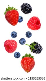 Berries in the air. Falling blackberry, raspberry, blueberry and strawberry fruits isolated on white