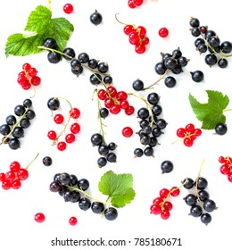 Berries of black and red currants isolated on white background. Still life, diet and nutrition concept. Flat lay. Top view.