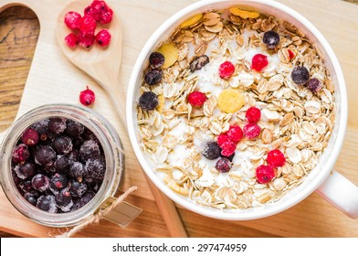 Berries in a bowl of muesli on the table top view