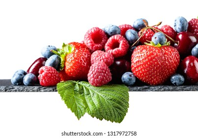Berries closeup colorful assorted mix of strawberry, blueberry, raspberry and sweet cherry isolated on white background.
