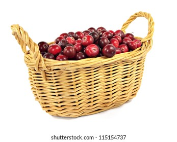 berries of a cranberry in basket on a white background