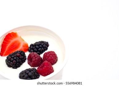Berries dipped in natural greek yogurt