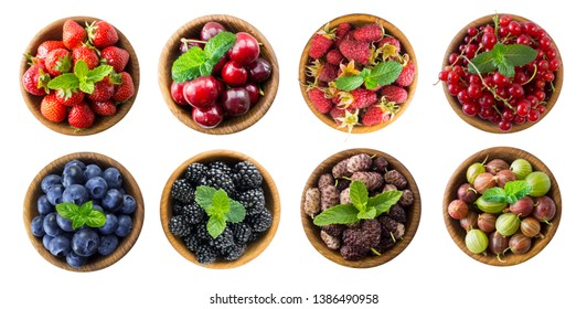 Berries and fruits isolated on white background. Collage of different fruits and berries. Raspberry, strawberry, currant, cherry, mulberry, blueberry, blackberry, gooseberry with mint leaves on white