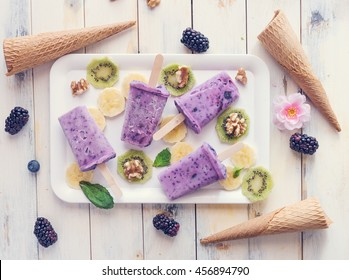 Berries ice pops with fruits and nuts