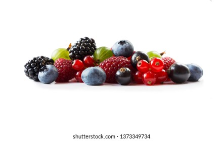 Berries isolated on white background. Ripe blueberries, blackberries, blackcurrants, raspberries, gooseberries and red currants. Mix fruits on white background. Mix berries with copy space for text.