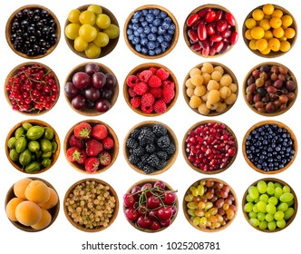 Berries isolated on white. Collage of different colors fruits and berries. Fruits and berries in bowl on white background. Sweet and juicy berry with copy space for text. Top view. Various fresh summe