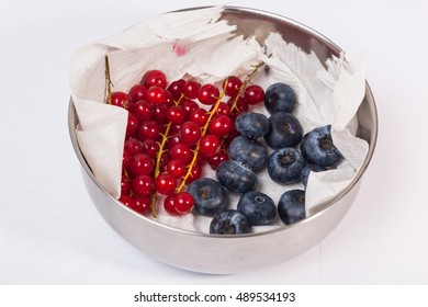 berries in a metal Bowl on white background