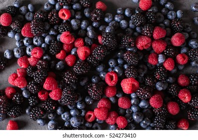berries mix on a gray abstract background
