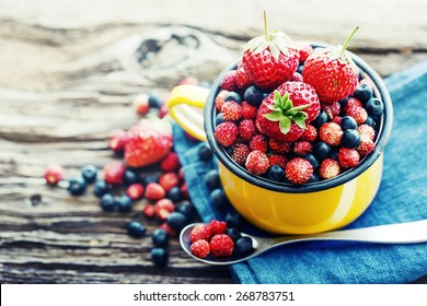 Berries on Wooden Background. Summer Organic Berry over Wood. Agriculture, Gardening, Harvest Concept