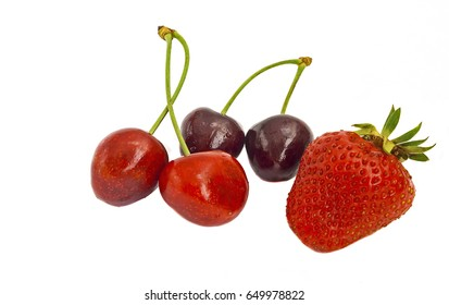 berries of ripe cherry and strawberry on white background