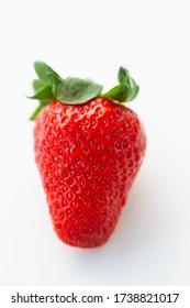 Berries - strawberries, raspberries, blueberries, blackberries - on white background in natural light