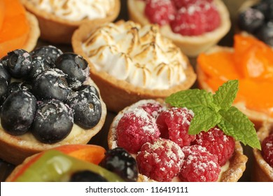 Berries tarts, peach and lemon tarts display