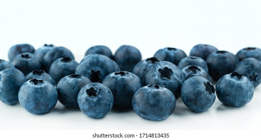 Berry background. Fresh berry blueberries on a white background. Concept of healthy and diet food. Flat lay, top view, Ripe blueberries with copy space for text, shallow DOF