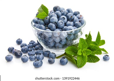 Berry blueberry with leaf mint close-up. Fruity still life for organic healthy food, isolated on white background, Top view.