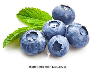 Berry blueberry with leaf mintclose-up. Fruity still life for organic healthy food, isolated on white background.