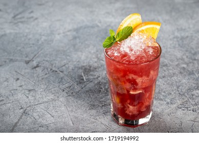 Berry cocktail with ice and orange slices