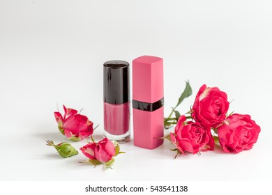 berry color decorative cosmetics with roses white background close up