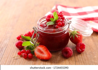 berry fruit jam in jar and fresh fruits
