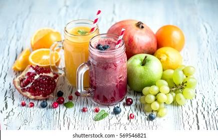 Berry and fruit smoothie, healthy juicy vitamin drink diet or vegan food concept, fresh vitamins