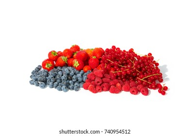 Berry fruits like strawberries, blueberries, red currants and raspberries in a bunch.