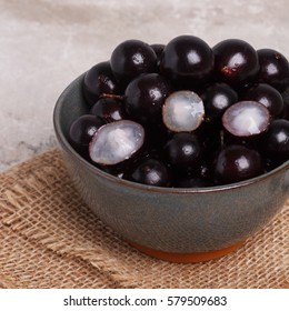 Berry Jaboticaba in bowl on marmory table. Selective focus