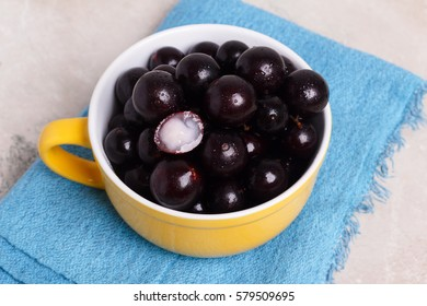 Berry Jaboticaba in bowl with towel on marble table. Selective focus
