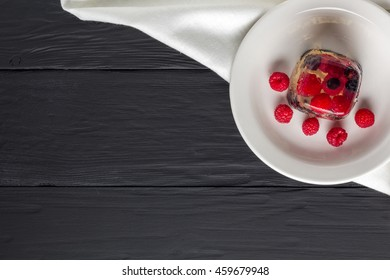 Berry jelly on a plate top view. Copyspace