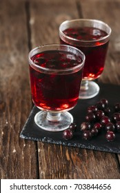berry juice in a glass with berries