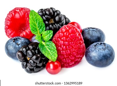 Berry mix isolated on a white background. Various fresh berries with mint  leaf. Raspberry, Blueberry, Cranberry, Blackberry. Macro.