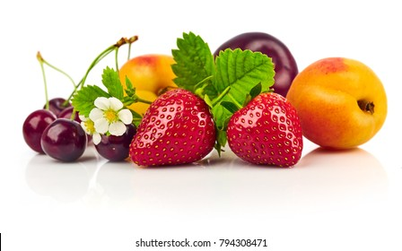 Berry mix with strawberry and raspberry. Fruity still life green leaf.