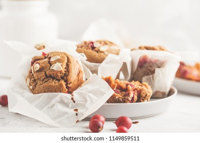Berry oatmeal nut muffins on a white background. Healthy vegan dessert.