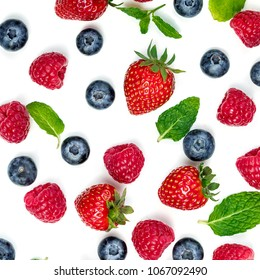 Berry Pattern. Fresh berries isolated on white background, top view. Strawberry, Raspberry, Blueberry and Mint leaf, flat lay