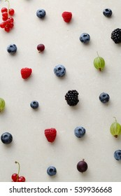 Berry pattern on concrete background, top view