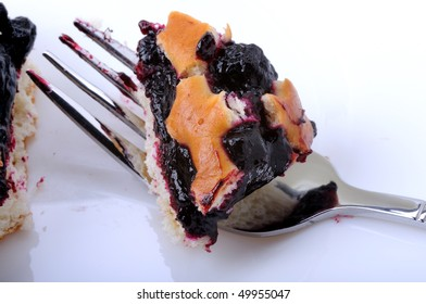 Berry pie on a plate and fork