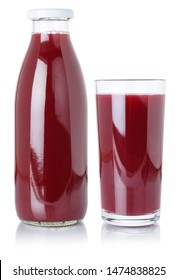 Berry smoothie fruit juice drink wild berries in a bottle and glass isolated on a white background