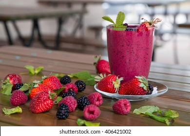 berry smoothie on a wooden table