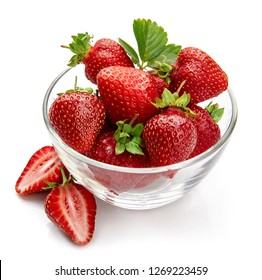 Berry strawberry with green leaf in glass dish fruit cut still life, isolated on white background.