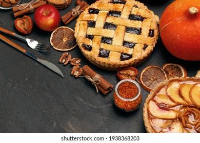 Berry tart pie and apple tart pie on black background