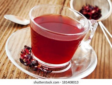 Berry Tea in Transparent Cup on Wooden Background, Delicious Tea Cup