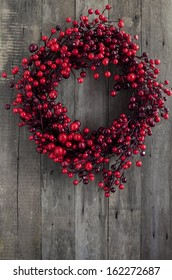 Berry wreath on wooden background